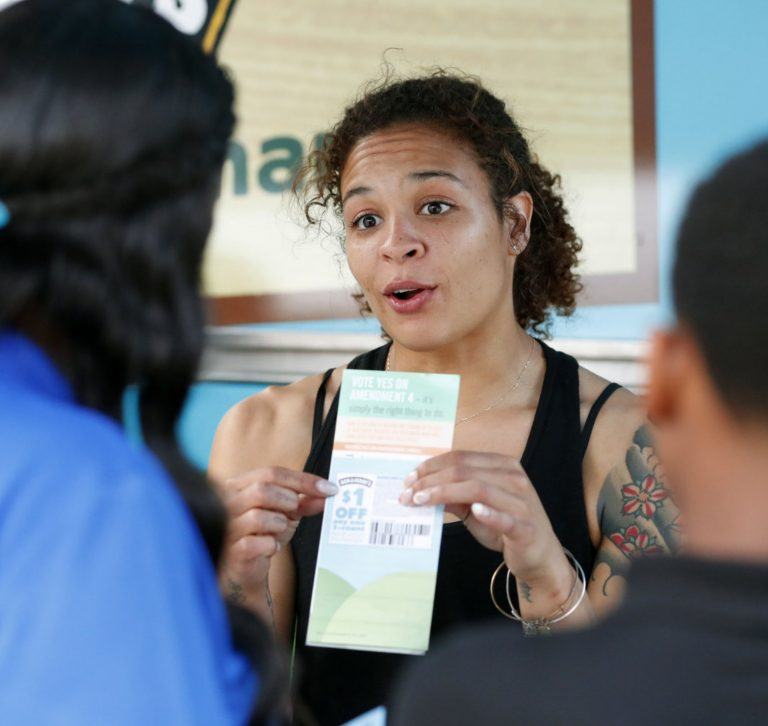 Woman leading a voter registration drive